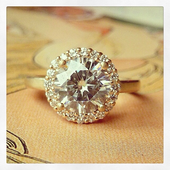 Round Moissanite and Diamond Halo Ring