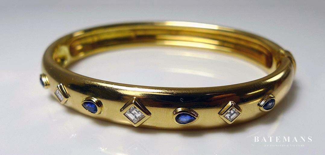 Diamond and Sapphire Studded Cartier Gold Bangle