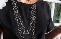 geometric necklace over black top