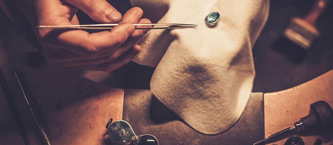 jeweller assessing diamond