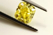cushion cut diamond in tweezers