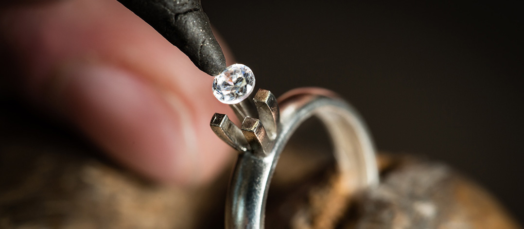 Diamond ring creation - setting the diamond in four claws