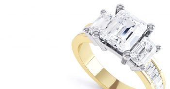 Emerald cut diamond ring with gold band and 3 stones