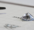 Sketch of a diamond ring with ethically sourced diamond on top of the to scale sketch
